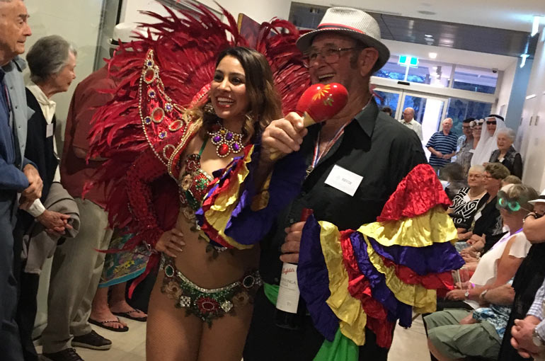 Woman and man in Carnivale costumes